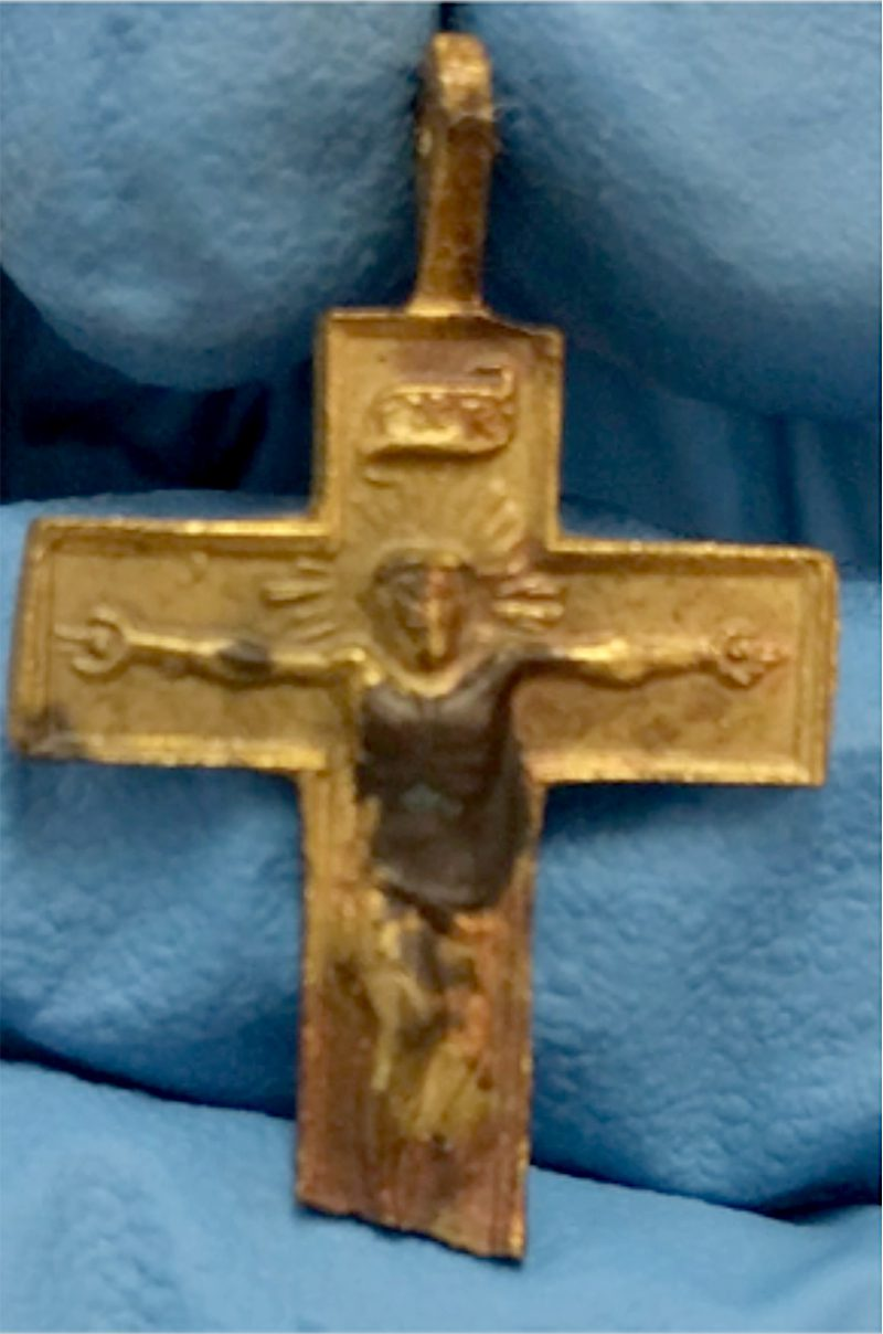 Centuries old gold crucifix artifact from the Tampa Bay History Center collection.