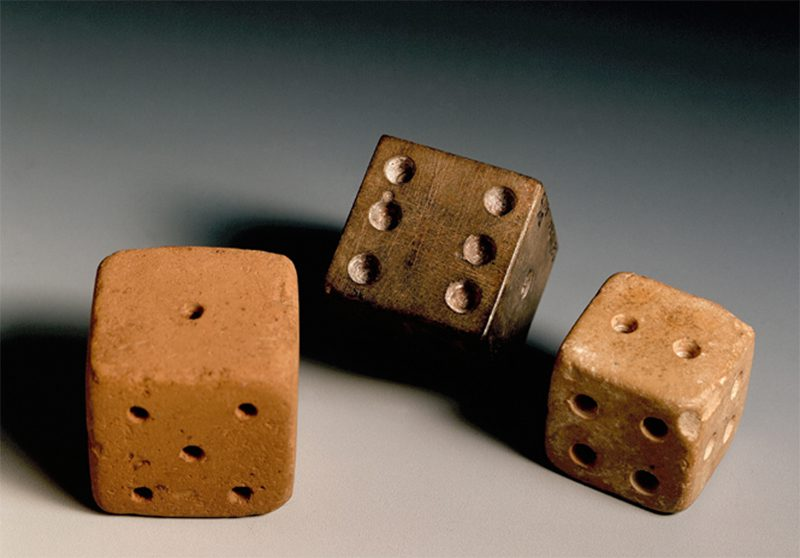 Photograph of a centuries-old playing dice artifact from the Tampa Bay History Center collection.